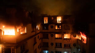 This image, obtained from social media, shows a residential building engulfed in flames in Paris on Feburary 5, 2019.