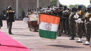 Côte d'Ivoire's  Laurent Gbagbo greets an honour guard after he is sworn in at the presidential palace on 4 December