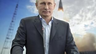 Le président russe Vladimir Poutine lors d'une conférence organisée avec l'équipage d'ISS, le 12 avril 2013.