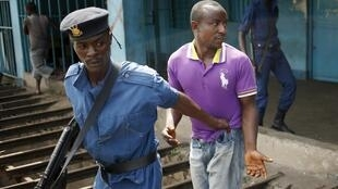 Burundi police arrest an anti-Nkurunziza protester in Bujumbura in early June