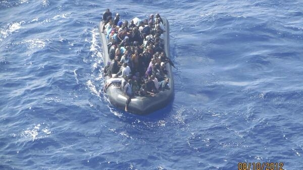 Some 93 immigrants are seen crammed onto a rubber dinghy near the Sicilian island Lampedusa, 8 October, 2012