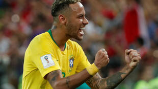 Brazil's Neymar celebrates after the match on June 27 against Serbia