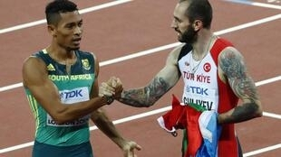 Ramil Guliyev (right) ended Wayde van Niekerk's attempt to win gold in the 200 and 400m at the world championships in London.