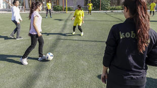 Delvin Ahmed, the local girls' football team coach, during a training session in Kobane, Syria