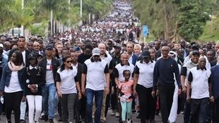 Rwandan President Paul Kagame (Right) leads thousands of Rwandans and several heads of state in a solemn walk to honour the victims of the 1994 genocide, Kigali, 7 April 2019
