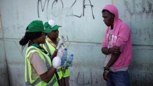 Lors d'une campagne de sensibilisation au danger du Covid-19 dans les rues de Port-au-Prince, le 15 mars 2020.