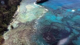 An undated photo shows the oil spill from the MV Solomon Trader along the coast of Rennell Island.