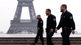 French police patrol at the Tocadero square near the Eiffel tower in Paris as a lockdown imposed to slow the rate of the coronavirus disease (COVID-19) contagion started at midday in France, France, March 17, 2020.