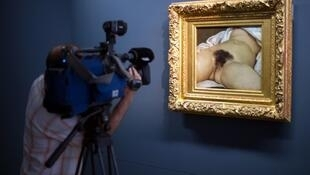 """This file photo taken on June 3, 2014 shows the Gustave Courbet's canvas """"L'origine du monde"""" at the Courbet museum.The young woman who served as a model for Gustave Courbet to was called Constance Queniaux, reveals French writer Claude Schopp."""