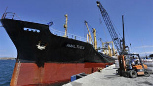 The Amalthea loads aid cargo in Greece before embarking for the Middle East.