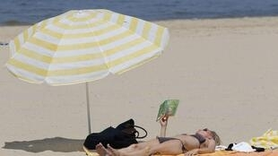 Nice when you get there - a woman sunbathes on the Bassin d'Arcachon, near Bordeaux