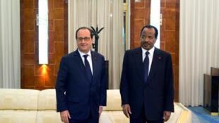 French President François Hollande with Cameroon's Paul Biya on Friday