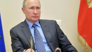 2020-04-01T143734Z_672386048_RC2QVF9LVBA8_RTRMADP_3_RUSSIA-PUTIN