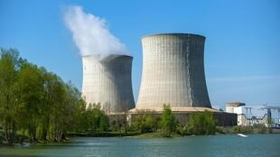 This image taken 20 April 2015 shows cooling towers of the nuclear station of Saint-Laurent-des-Eaux, one of several along the Loire River in central France.