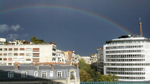 After the rain - a rainbow over Paris on Tuesday afternoon