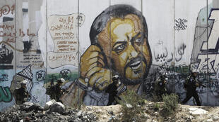 A portrait  of Marwan Barghouti on israel's separation wall near Ramallah on the West Bank