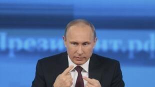 Le président russe Vladimir Poutine lors de sa conférence de presse annuelle le 19 décembre 2013.