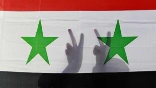 Protesters in Jordan against the Syrian regime