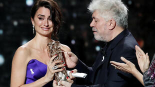 Actress Penelope Cruz reacts after receiving her Honorary Cesar with director Pedro Almodovar.