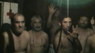 The trapped miners are seen underground in a screenshot from the video footage. 29 August 2010