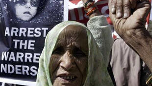 Activists from the Bhopal Gas Tragedy Survivors Group protest ahead of the 25th anniversary of the tragedy