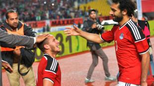 Les Egyptiens Ramadan Sobhi (à gauche) et Mohamed Salah, le 29 mars 2016.