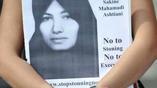 A member of the International Committee against Stoning Sakineh Mohammadi Ashtiani holds a poster at a protest in London