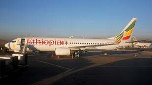 Workers service an Ethiopian Airlines Boeing 737 plane at the Bole International Airport in Ethiopia's capital Addis Ababa