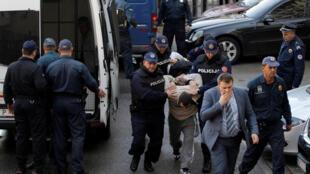 Черногорская полиция доставила задержанных «путчистов» в суд 16 октября 2016