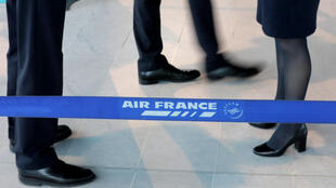 Air France employees stand at the check in desk at Nice airport as Air France pilots, cabin and ground crews unions call for strike over salaries in France.