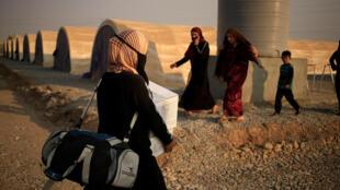Habitantes de Mossul deixam a cidade antes da chegada das tropas iraquianas