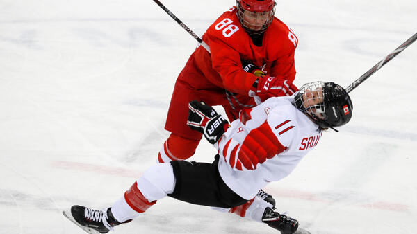 Jillian Saulnier of Canada comes up against Russia's Yekaterina Smolina on Monday