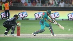 Babar Azam plays a shot during the Pakistan-New Zealand T20 match in Dubai.