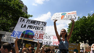 Youth activists in France join global protests led by Swedish teenager Greta Thunberg calling for climate action to halt global warming, 15 March 2019.