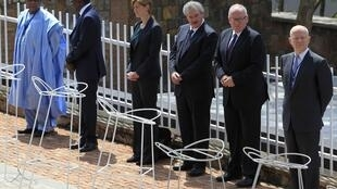 British Foreign Secretary William Hague (R) with other dignitaries at the commemoration of the Rwandan genocide this year