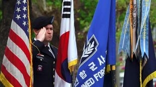 A US soldier salutes during the General Walker Monument Transition Ceremony at a US Army base in Seoul on April 25, 2017 marking the beginning of the US Eighth Army's move from Yongsan to Camp Humphreys in Pyeongtaek.