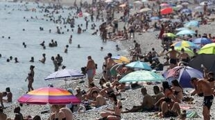 People cool off in the sea in Nice as a heatwave hits much of the country, France, 27 June 2019.