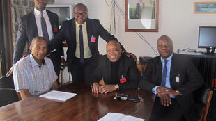 Michel Thierry Atangana (L) with his lawyers at the French ambassador's residence in Yaoundé