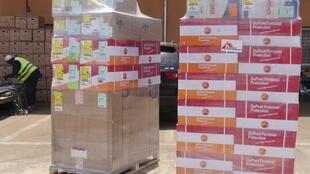 Doctors Without Borders unloads emergency medical supplies in Conakry to fight Ebola