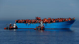 Migrants on a wooden boat are rescued by the Malta-based NGO Migrant Offshore Aid Station (MOAS) off Libya