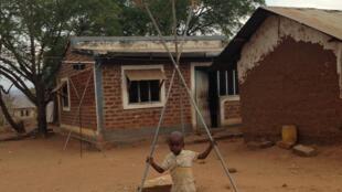 A little boy plays under a solar tower in Melela Mlandizi, Tanzania