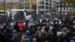 Migrants are moved from a camp at the Stalingrad metro station in Paris