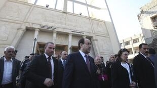Iraq's Prime Minister Nuri al-Maliki at Our Lady of Salvation church on 9 November, scene of the siege ten days earlier.