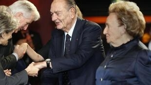 This file picture shows former President Jacques Chirac with his wife at the Musee du Quai Branly in Paris on 21 November, 2013.