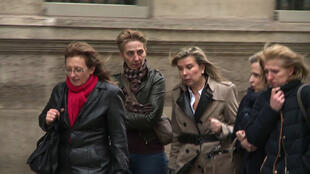January 29, 2016 taken from an AFPTV video shows Sylvie (L), Fabienne (2ndL) and Carole Marot (R), daughters of Jacqueline Sauvage who shot her husband on September 10, 2012 after he abused her for decades, arriving with their lawyers at the Elysee Palace.