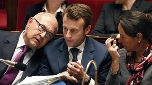 Finance Minister  Michel Sapin (L) with Economy Minister Emmanuel Macron (C) and Environment Minister Ségolène Royal