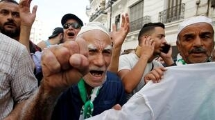 Demonstrators gesture during a protest opposing the election that Algeria's veteran ruling cadre has set for December, in Algiers, Algeria October 1, 2019.