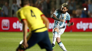 Argentina's Lionel Messi shoots to score a goal against Columbia on Tuesday.