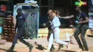 A hostage is rushed oiut of the Bamako Radisson Blu hotel