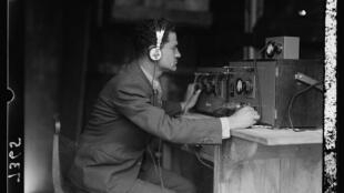 Radio engineer Moshe Rubin transmits the special broadcast during the opening of the Palestine Broadcasting Service, Ramallah, March 30, 1936